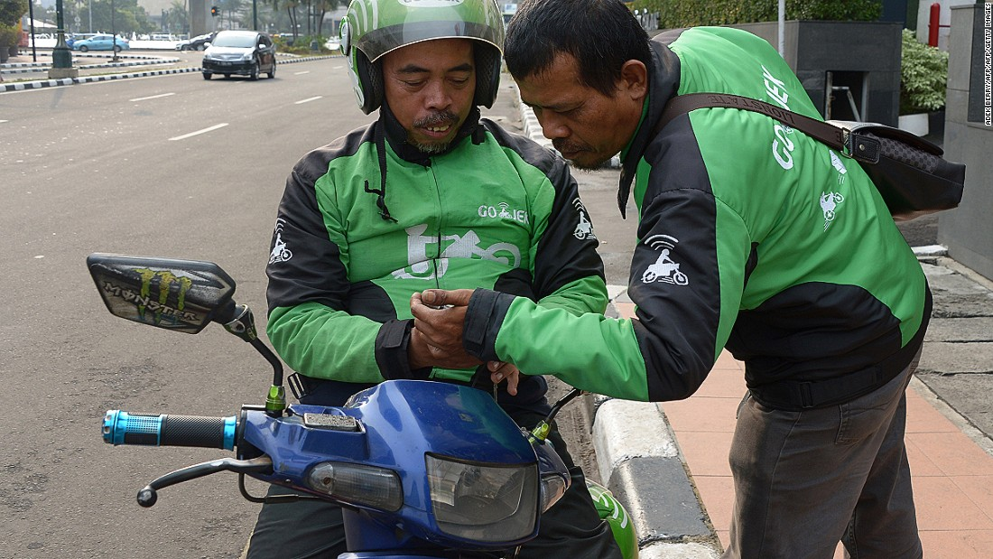 Drivers log onto the Go-Jek app, which has seen 25 million downloads since its launch in 2015.