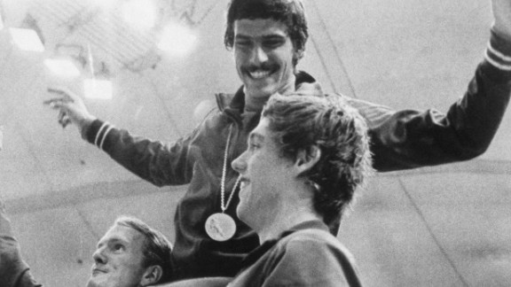 <strong>Spitz wins seven: </strong>Before Michael Phelps, there was Mark Spitz. Spitz, seen here on the shoulders of American teammates Tom Bruce and Mike Stamm, won seven swimming events at the 1972 Summer Games in Munich, Germany. It was the most golds won at one Olympics until Phelps won eight in 2008.