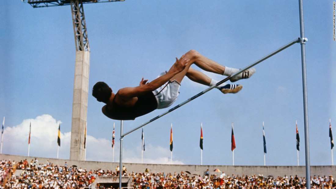 "<strong>The Fosbury Flop: </strong>American high jumper Dick Fosbury clears the bar on the way to winning gold at the 1968 Summer Games in Mexico City. His ""back-first"" jumping style revolutionized the sport and is now used by almost everyone who competes in the event."