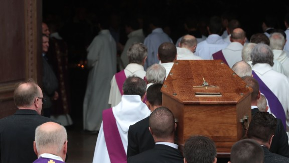 Pallbearers carry the coffin of the Rev. Jacques Hamel into Rouen
