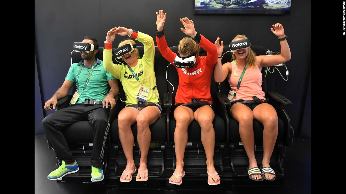 Members of the German Olympic team try out virtual-reality headsets on August 1.