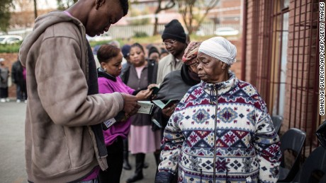 South African voters get their identifications checked before voting during municipal elections in Johannesburg on August 3, 2016.