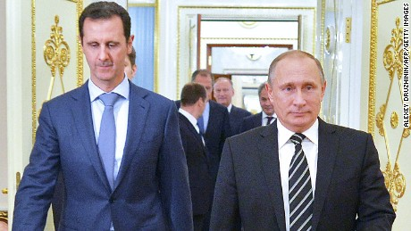 "Russian President Vladimir Putin (R) greets his Syrian counterpart Bashar al-Assad upon his arrival for a meeting at the Kremlin in Moscow on October 20, 2015. Assad, on his first foreign visit since Syria's war broke out, told his main backer and counterpart Putin in Moscow that Russia's campaign in Syria has helped contain ""terrorism"".  / AFP / RIA NOVOSTI / ALEXEY DRUZHININ        (Photo credit should read ALEXEY DRUZHININ/AFP/Getty Images)"