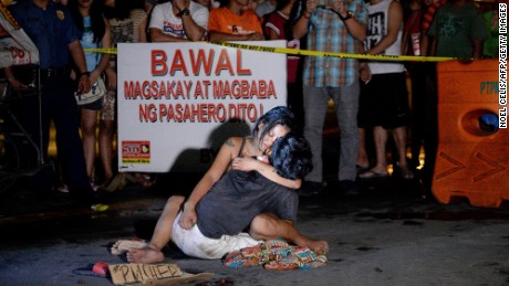 "The 'Pieta"" photograph, in which Jennilyn Olayres clings to the body of her partner, Michael Siaron, who was shot dead by an unidentified gunman in Pasay City, Metro Manila, in July 2016."