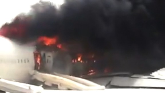 Flames engulfed the plane after all 300 people on board escaped.