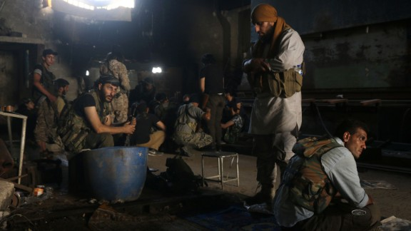 Opposition fighters rest in Aleppo