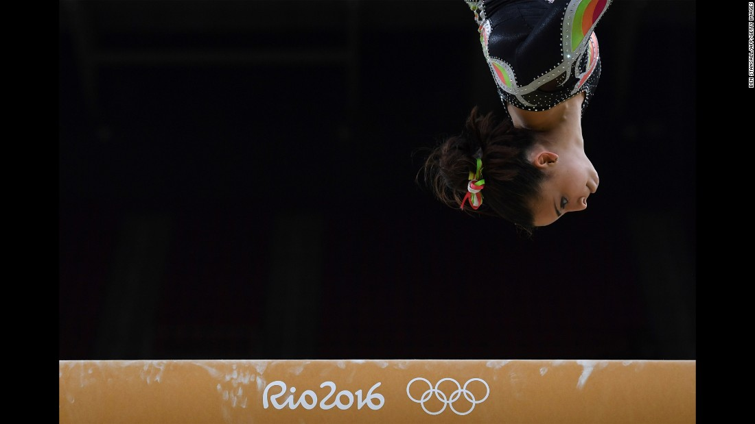 Panama's Isabella Amado practices on the balance beam on August 4.