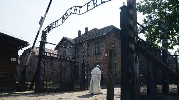 Pope Francis passes the main entrance to Auschwitz-Birkenau, the former concentration camp in Poland, on Friday, July 29, 2016. The Pope was there to pay tribute to those who died in the Holocaust.