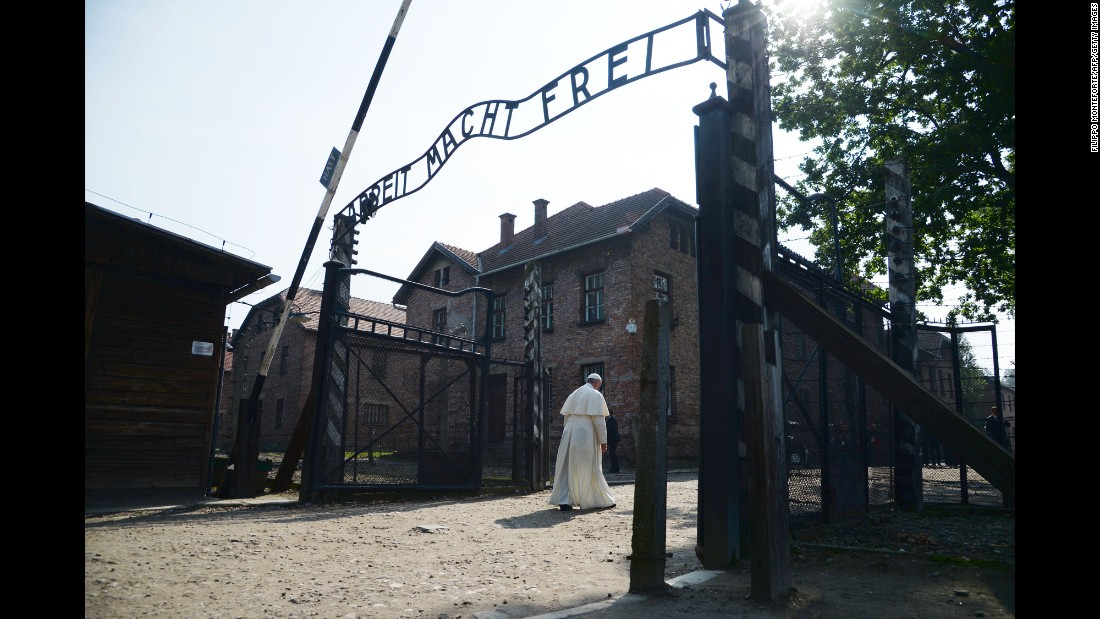 "Pope Francis passes the main entrance to Auschwitz-Birkenau, the former concentration camp in Poland, on Friday, July 29, 2016. The Pope <a href=""http://www.cnn.com/2016/07/29/europe/poland-pope-auschwitz-visit/"" target=""_blank"">was there to pay tribute</a> to those who died in the Holocaust."