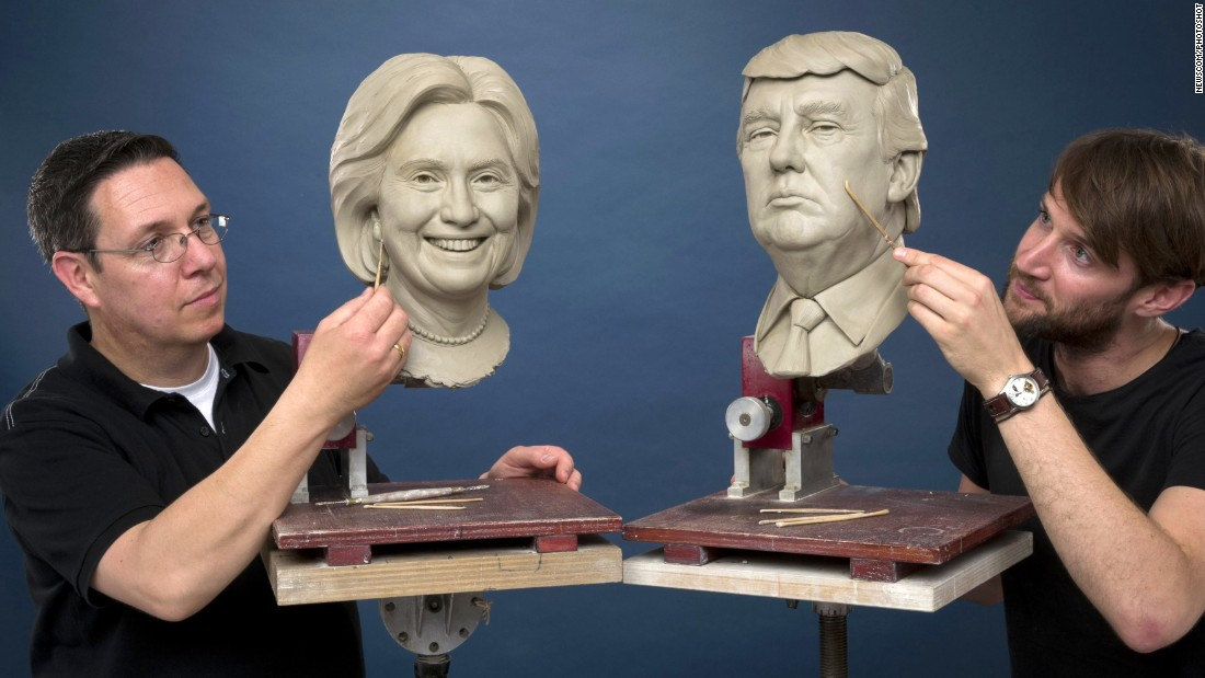 People work on clay sculptures of Hillary Clinton and Donald Trump in this image released Monday, August 1, by Madame Tussauds London. Only one will be used to create a wax figure of the next U.S. President.
