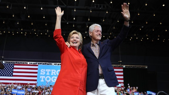 Democratic presidential nominee former Secretary of State Hillary Clinton and her husband former U.S. president Bill Clinton greet supporters during a campaign rally with democratic vice presidential nominee U.S. Sen Tim Kaine (D-VA) at the David L. Lawrence Convention Center on July 30, 2016 in Pittsburgh, Pennsylvania.