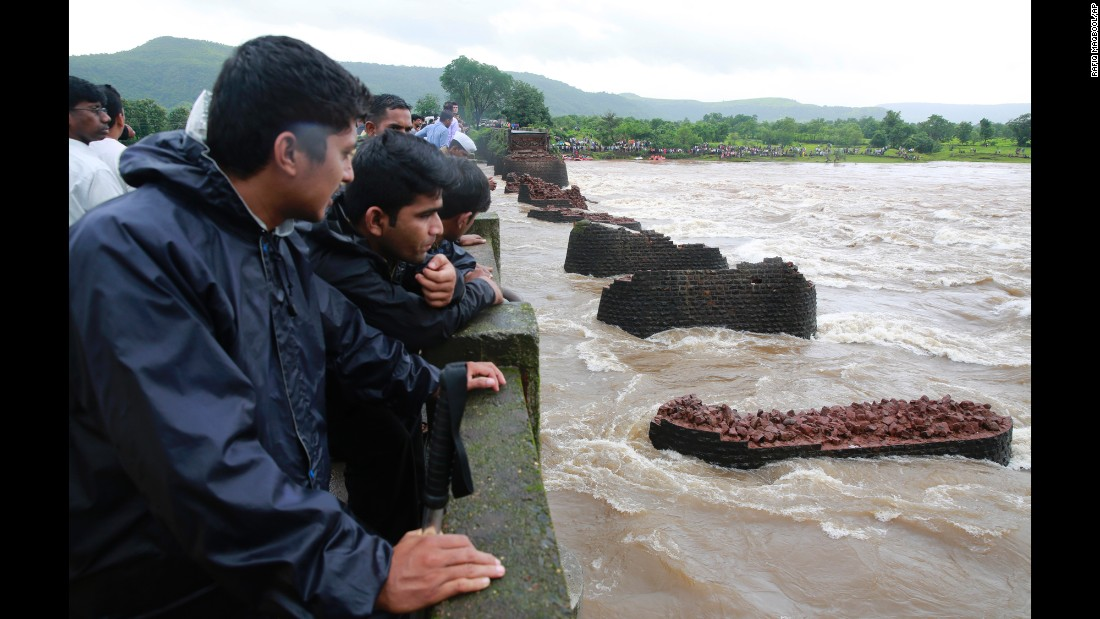 "People watch a search operation after <a href=""http://www.cnn.com/2016/08/03/asia/india-bridge-collapse-flooding/"" target=""_blank"">an old bridge collapsed</a> in Mahad, India, on Wednesday, August 3. Two passenger buses tumbled into the floodwaters below."