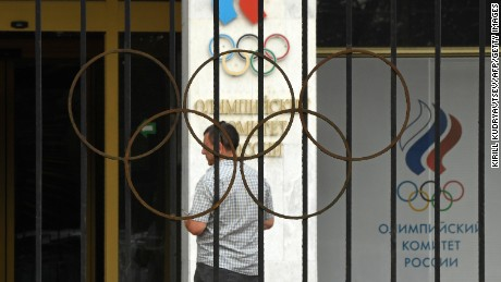 "A man walks in front of the Russian Olympic Committee (ROC) building in Moscow on July 25, 2016. Russia breathed a sigh of relief after the IOC declined to impose a blanket ban on its competitors at the Rio Games over state-run doping, but the decision met fierce criticism elsewhere with Olympic chiefs branded ""spineless"". In one of the most momentous moves in its chequered history, the International Olympic Committee said on July 24, 2016, it was up to each international sports federation to decide if Russians could take part in Rio. The federations now face a race against the clock with the opening ceremony only 11 days away, global sport sharply divided and some Russian competitors already in Brazil. / AFP / Kirill KUDRYAVTSEV        (Photo credit should read KIRILL KUDRYAVTSEV/AFP/Getty Images)"