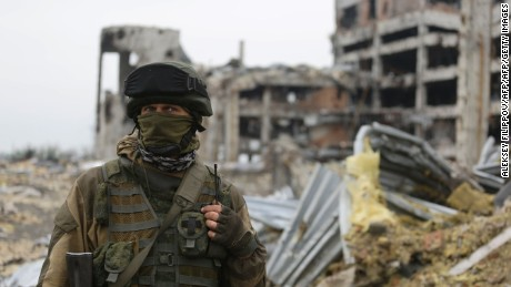 An armed pro-Russian separatist of the self-proclaimed Donetsk People's Republic (DNR) stands in front of the destroyed Donetsk International Airport, in Donetsk, on June 1, 2016. Ukraine's pro-Russian eastern insurgents on June 1 accused Kiev's soldiers of launching a new blitz near a prized but long-obliterated airport in the separatists' de facto capital of Donetsk. The claim appears to fit with a mounting death toll reported by the pro-Western leadership in Kiev and foreign monitors from the Organization for Security and Co-operation in Europe (OSCE). / AFP PHOTO / Aleksey FilippovALEKSEY FILIPPOV/AFP/Getty Images