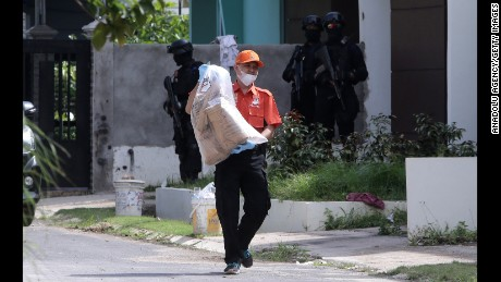 Anti-terror police conduct a raid Friday on the Indonesian island of Batam.