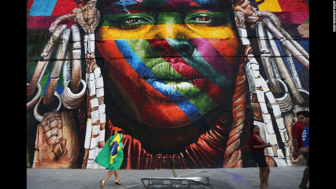 "A mural depicts an indigenous face created by Brazilian graffiti artist Eduardo Kobra and assistants on August 4. The 32,000-square-foot ""We Are All One"" celebrates cultural diversity."