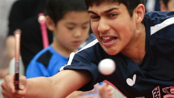 FILE - In this June 18, 2016, file photo, Kanak Jha of the U.S. returns a shot during an exhibition table tennis match in Dunellen, N.J. China's overwhelming domination of table tennis at the Olympics will likely continue in Rio, but there's drama about just which member of the fantastically talented Chinese national team will prevail. The United States has never medaled in table tennis, but there is excitement about the future. Kanak Jha, now 16, was the youngest male to qualify for table tennis in Olympic history when he made the U.S. team in April while still 15. (AP Photo/Julie Jacobson, File)