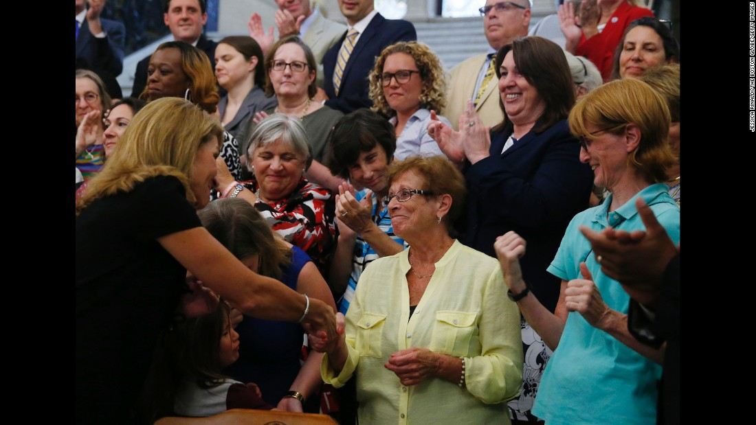 "Massachusetts Lt. Gov. Karyn Polito, left, shakes hands with Dorothy Simonelli, a former high school lunch lady who fought for equal pay decades ago, at the State House in Boston on Monday, August 1. Gov. Charlie Baker <a href=""http://www.masslive.com/politics/index.ssf/2016/08/gov_charlie_baker_signs_massac.html"" target=""_blank"">was signing an update</a> to the state's equal pay law."