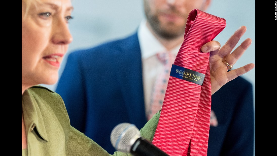 Democratic presidential nominee Hillary Clinton holds up a Donald Trump tie, which wasn't made in the United States, as she speaks at the Knotty Tie Company in Denver on Wednesday, August 3. The Knotty Tie Company makes ties and scarves by hand in Denver.