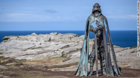 TINTAGEL, UNITED KINGDOM - APRIL 28:  The new 'Gallos' sculpture that has been erected at Tintagel Castle is seen in Tintagel on April 28, 2016 in Cornwall, England. The English Heritage managed site and the nearby town have long been associated with the legend of King Arthur and continue to attract large visitor numbers. However, efforts by English Heritage to update the visitor experience with the Gallos sculpture, along with a rock carving of Merlin's face, which English Heritage say are inspired by the legend of King Arthur and Tintagel Castles royal past, have met with criticism from some Cornish nationalists and historians. (Photo by Matt Cardy/Getty Images)