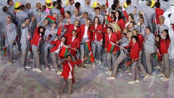 Belarus team members pose for photographs while entering the stadium.