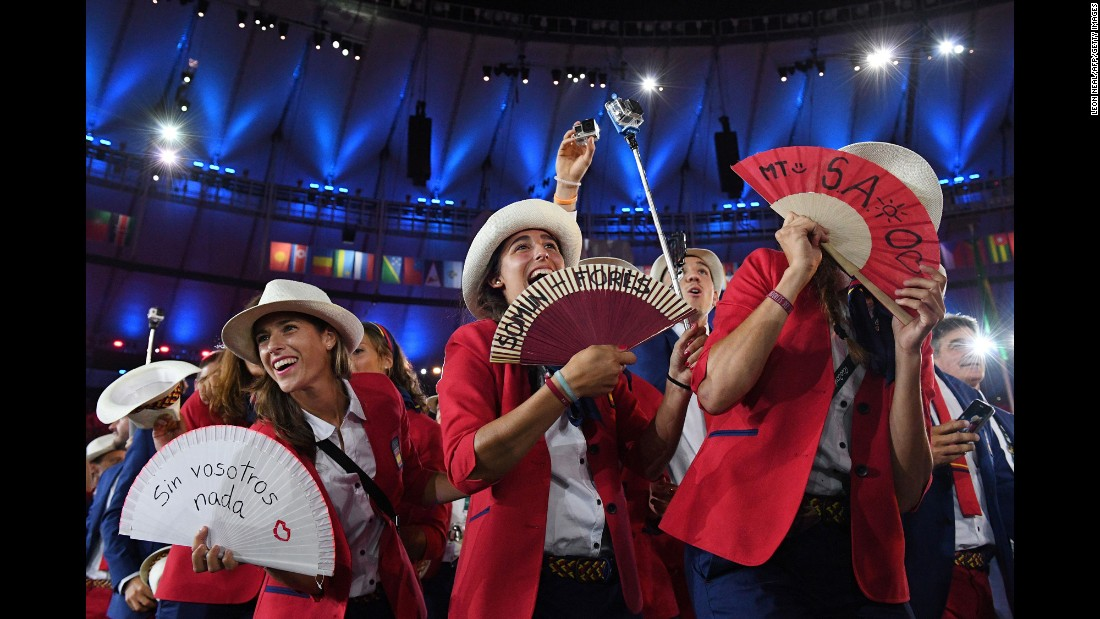 Members of Spain's delegation wave fans during the ceremony.