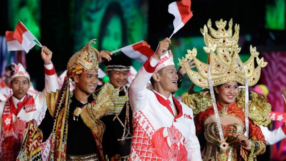 Members of Indonesia's Olympic team walk during the parade of nations.