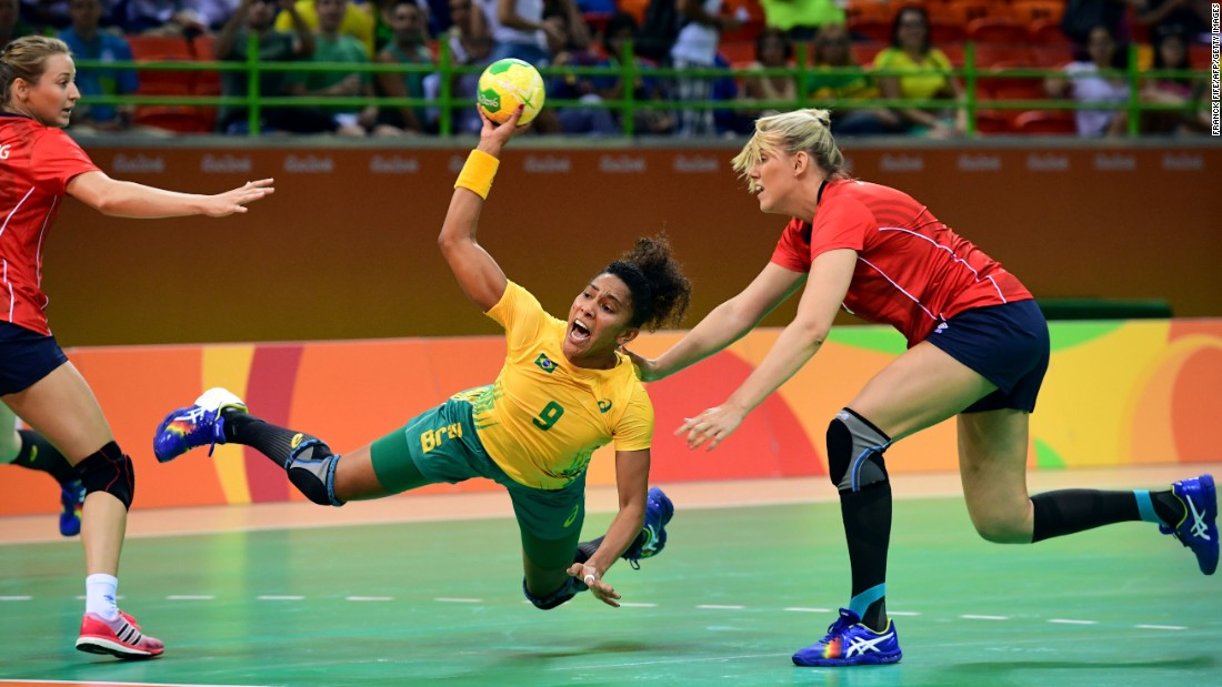 Brazil's Ana Paula Belo, center, shoots during the women's preliminaries Group A handball match against Norway.