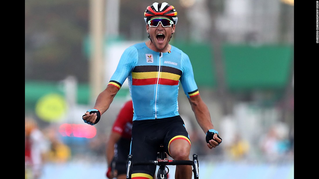 Greg Van Avermaet of Belgium celebrates winning the gold medal after crossing the finishing line the men's road race.
