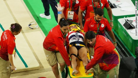 Samir Ait Said receives medical attention after breaking his leg while competing on the vault.