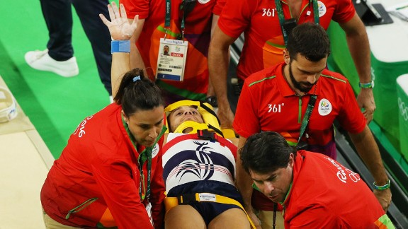 Samir Ait Said of France receives medical attention after breaking his leg on the vault during the artistic gymnastics team qualification round on Saturday, August 6.
