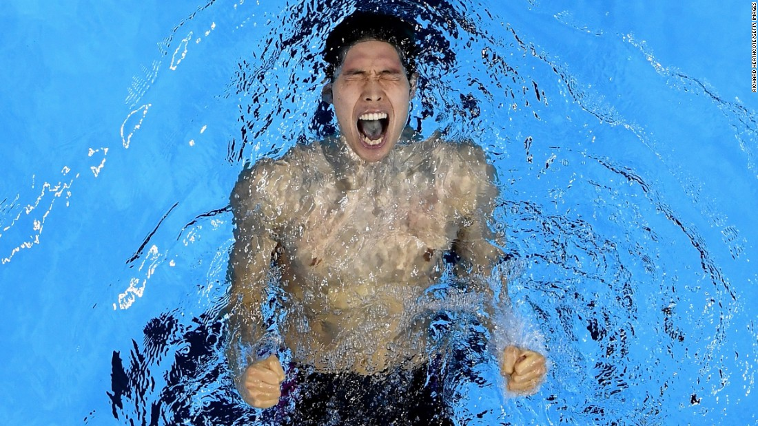 Kosuke Hagino of Japan celebrates winning gold in the final of the men's 400-meter individual medley on the first day of competition at the 2016 Olympic Games on Saturday, August 6.