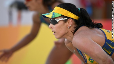 Brazil's Barbara Seixas De Freitas prepares to receive the ball during the women's beach volleyball qualifying match between Brazil and the Czech Republic at the Beach Volley Arena in Rio de Janeiro on August 6, 2016, for the Rio 2016 Olympic Games. / AFP / Yasuyoshi Chiba        (Photo credit should read YASUYOSHI CHIBA/AFP/Getty Images)