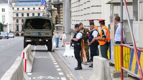 Police outside Belgium's Prime Minister's Office in Brussels on Sunday following an attack on two policewomen in the southern city of Charleroi.