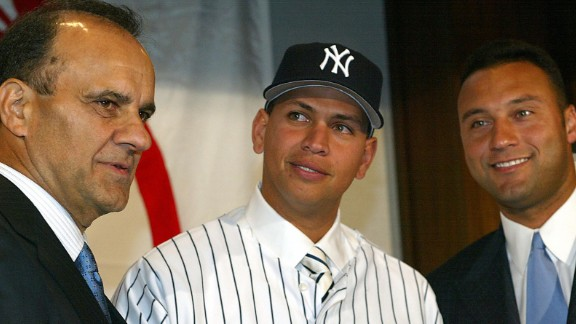 Rodriguez, center stands with Yankees Manager Joe Torre, left, and Derek Jeter at a press conference at Yankee Stadium on February 17, 2004 to formally welcome him to the team. Rodriguez was traded to the Yankees from the Texas Rangers in exchange for Alfonso Soriano and Joaquin Arias.