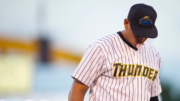 Rodriguez blows a bubble during a minor league game for the AA Trenton Thunder in Trenton, NJ on August 3, 2013. Major League Baseball suspended Rodriguez for 211 regular-season games through the 2014 season amid allegations involving the use of performance-enhancing drugs.
