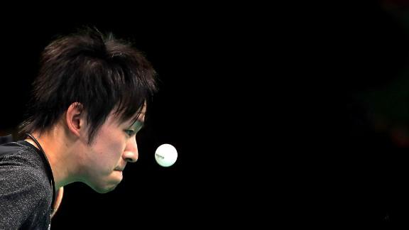 Koki Niwa of Japan is focused on the ball during his men's singles table tennis match match against Segun Toriola of Nigeria.