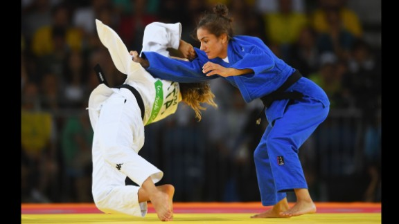 """Majlinda Kelmendi of Kosovo (blue) competes with Odette Giuffrida of Italy during the women's 52 kg judo gold medal final. Kelmendi <a href=""""http://cnn.com/2016/08/07/sport/majlinda-kelmendi-kosovo-olympics/index.html"""" target=""""_blank"""">won Kosovo's first ever Olympic medal.</a>"""
