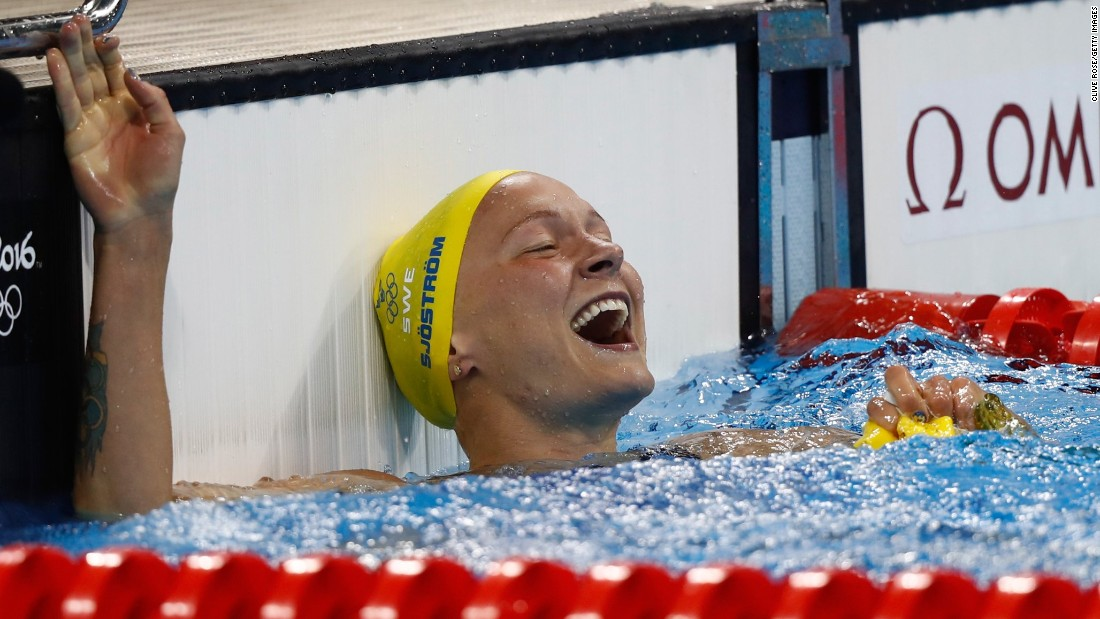 Sarah Sjostrom of Sweden celebrates winning gold and setting a new world record in the women's 100m butterfly.