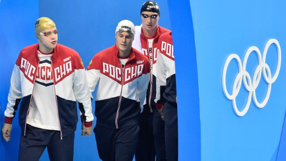 Russia's Andrey Grechin, Danila Izotov, Vladimir Morozov and Alexander Sukhorukov arrive for the men's 4x100-meter freestyle final during the swimming competitions at the 2016 Summer Olympics, Sunday, Aug. 7, 2016, in Rio de Janeiro, Brazil. (AP Photo/Martin Meissner)