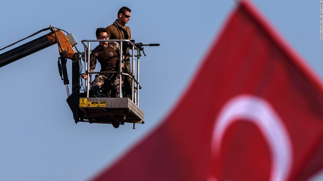 Security was predictably tight -- as these Turkish special forces snipers high above the crowd illustrate.
