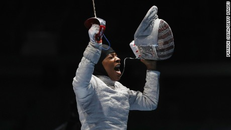Ibtihaj Muhammad of the United States celebrates victory over Olena Kravatska of Ukraine during the Women's Individual Sabre on Day 3 of the Rio 2016 Olympic Games at Carioca Arena 3 in Rio de Janeiro.