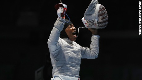 Ibtihaj Muhammad of the United States celebrates victory over Olena Kravatska of Ukraine during the Women's Individual Sabre on Day 3 of the Rio 2016 Olympic Games at Carioca Arena 3 on August 8, 2016 in Rio de Janeiro, Brazil.