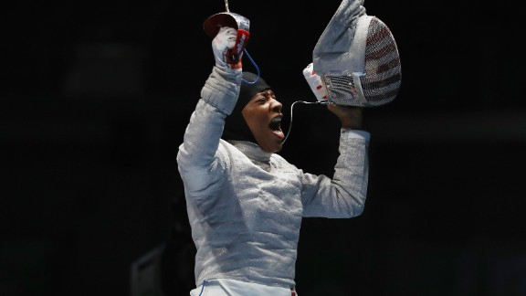 U.S. fencer Ibtihaj Muhammad celebrates after defeating Ukraine's Olena Kravatska in the individual sabre competition on Monday, August 8. Muhammad is the first U.S. Olympian to compete in hijab.