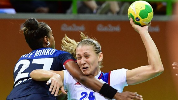 France's Estelle Nze-Minko, left, competes against Russia's Irina Bliznova during a preliminary handball match.