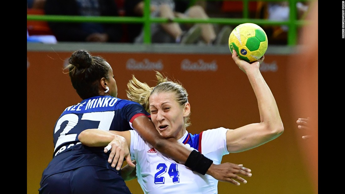 France's Estelle Nze-Minko, left, competes against Russia's Irina Bliznova during a preliminary handball match.