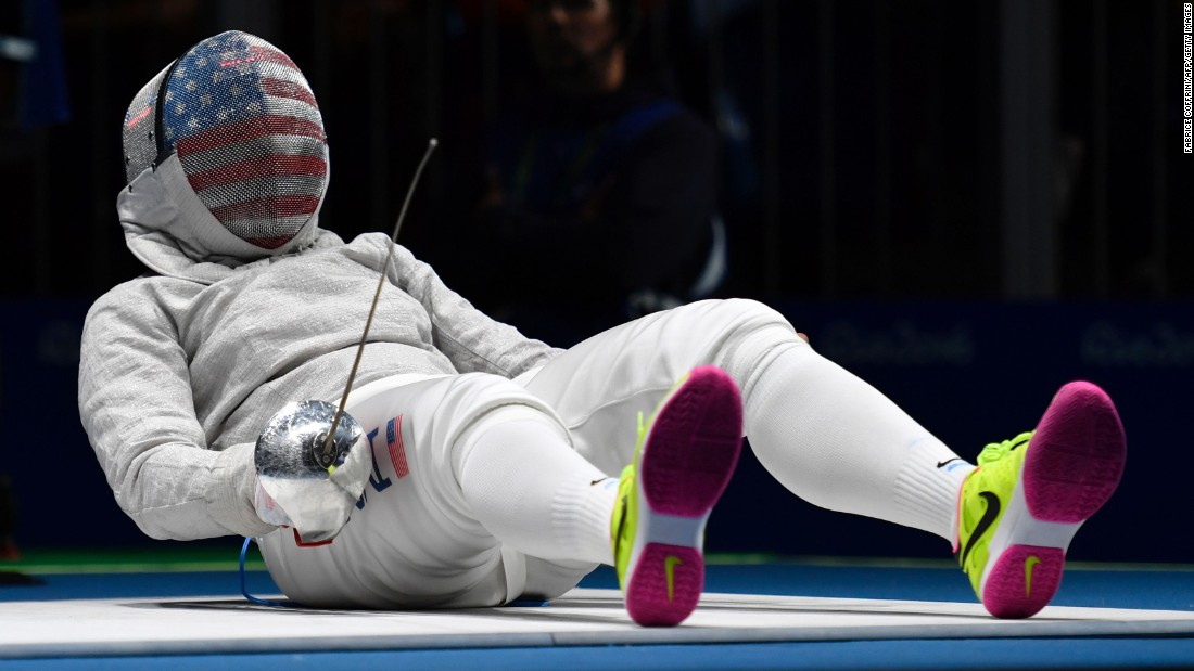 "Ibtihaj Muhammad, <a href=""http://www.cnn.com/2016/08/08/sport/ibtihaj-muhammad-individual-sabre-fencing-2016-rio-olympics/index.html"" target=""_blank"">the first American to wear a hijab in the Olympics,</a> reacts on the piste as she competes against France's Cecilia Berder in a fencing bout. Berder won 15-12 to advance to the quarterfinals of the sabre competition."