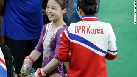 South Korea's Lee Eun-ju, left, smiles as she talks with North Korea's Hong Un Jong during the artistic gymnastics women's qualification at the 2016 Summer Olympics in Rio de Janeiro, Brazil, Sunday, Aug. 7, 2016. (AP Photo/Dmitri Lovetsky)