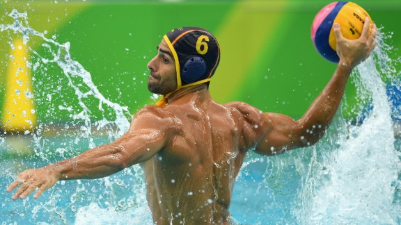Spanish water polo player Marc Minguell shoots for goal during a 10-9 victory over the United States.