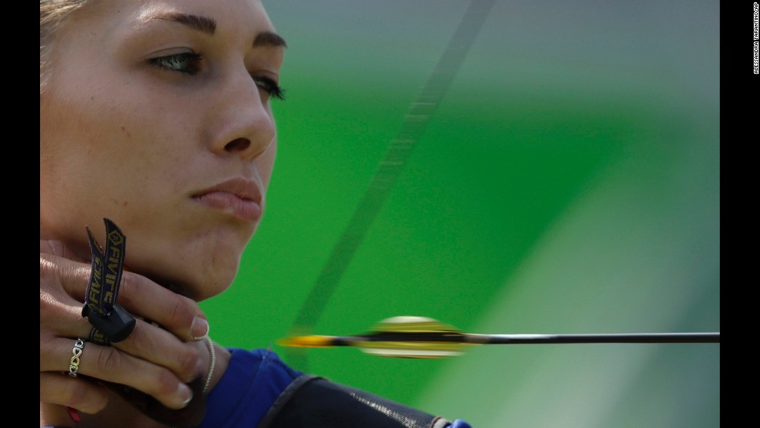 Slovakia's Alexandra Longova releases an arrow during the women's individual archery competition.